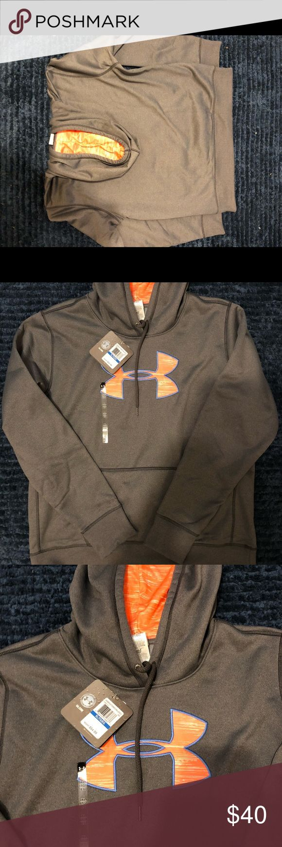 Women's Under Armour Hoodie NWT Women's XL Under Armour Hoodie. Gray with peachy neon orange symbol with powder blue outline. Brand new with tags. Closet kept in a smoke free home. Under Armour Tops Sweatshirts & Hoodies
