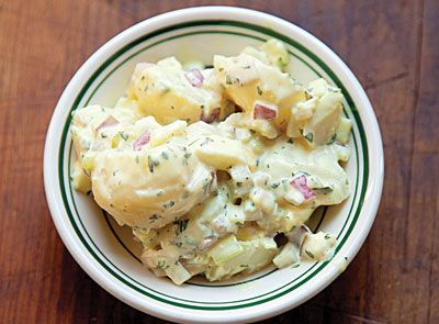 What's a barbecue without potato salad? This recipe from #saveur mixes pickle relish and mayonnaise for sweetness with crisp red onion to make the perfect taste combination that pairs beautifully with a tangy, vinegar dressed pulled pork.