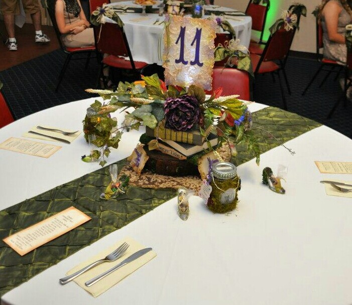 Transforming the hall. Centerpiece Enchanted Faery Quinceanera lantern favors  faery slippers favors, faery dust necklace favors
