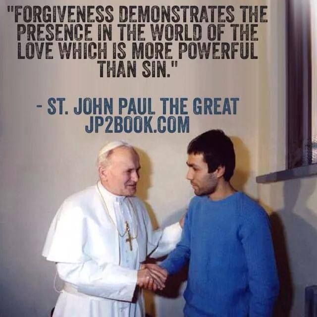 St. Pope John Paul II with the man that attempted to kill him. Pope John Paul the Great forgave the world be killer in person.