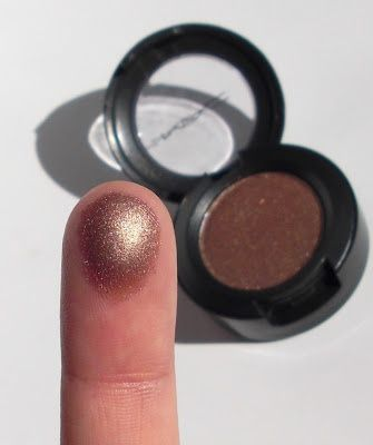 "To try: Mac ""Tempting"" eyeshadow. Apparently will REALLY makes blue eyes pop"