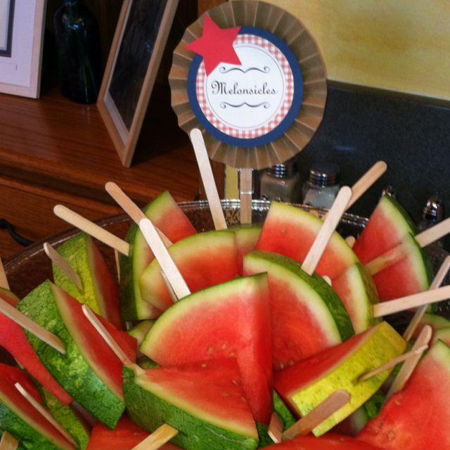 """Fun & easy way to cut watermelon for any BBQ or picnic! We called ours """"Melonsicles""""! Cut watermelon in triangles, use a paring knife to cut a small slit in the rind, then pop in your Popsicle stick! Instant Melonsicle! Guests walked around eating melon! It was fun! Food clothespin designed by Sweet Talk Designs on Etsy."""