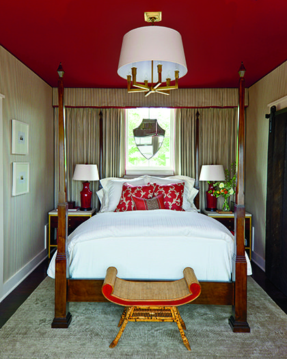 A red ceiling is unexpected in a bedroom by Phoebe Howard