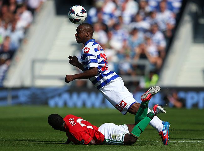 Junior Hoilett gets the ball clear as Swansea's Nathan Dyer looks on
