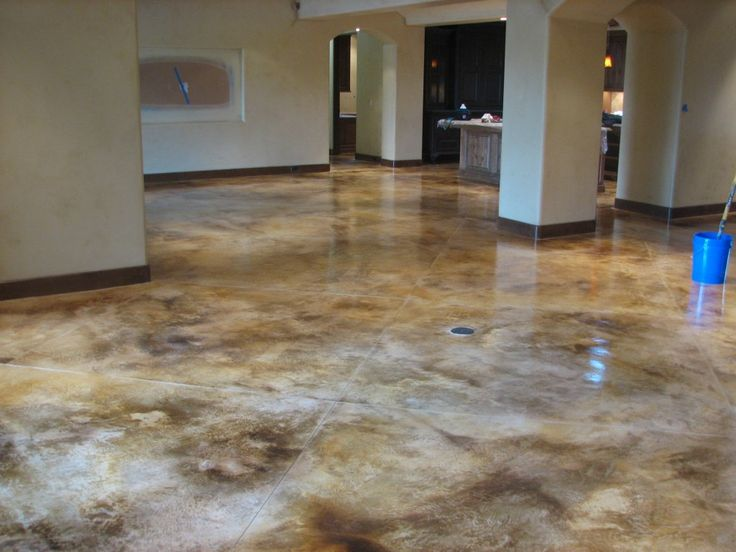 Interior decorative concrete interior mottled for Stained concrete inside house