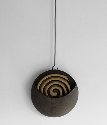 """Hanging Coil Burner:  Draws on the materials and skills of traditional Japanese craft to produce beautiful contemporary products.  Produced at the Morihisa Suzuki Workshop in Morioka Iwate, hometown of """"Nanbu Iron"""". The Workshop has produced iron products since 1625; their traditional metal-casting method gives there products a distinctive texture. $96.79USD"""