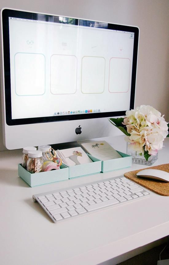 I like the simplicity of what is on the desk's surface and add a touch of natural beauty--flower in a vase.