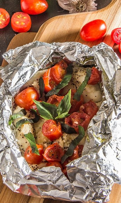 flaky grilled fish and warm cooked tomatoes are complemented by flavorful white wine, garlic, and rich olive oil.