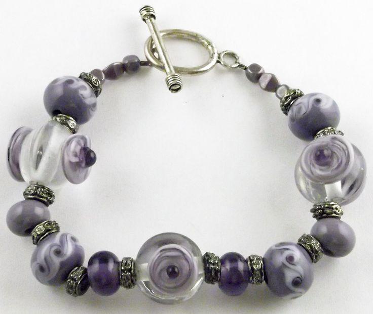 Purple dots on clear glass.  Lampwork glass bead bracelet
