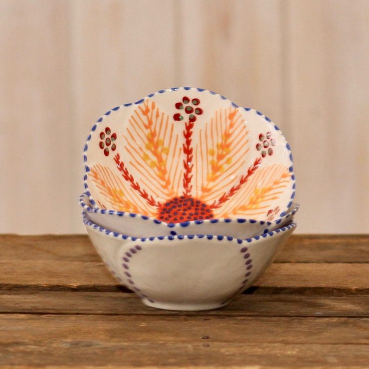 Orange and Red Peanut Bowl // ibbi direct  Our peanut bowls are perfect for nuts, olives and small puddings. Each bowl is hand painted and is dishwasher safe. Made to mix and match  #bowls #ceramics #tablesetting #tableware #entertaining #interiors #gifting #ceramicbowl #orangebowl #ibbidirect
