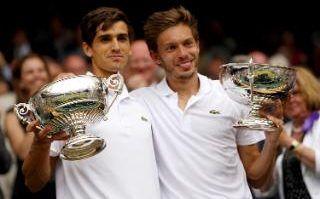 Pierre-Hugues Herbert and Nicolas Mahut celebrate their doubles triumph