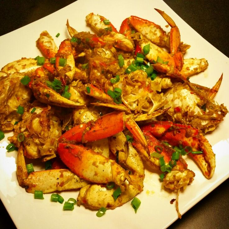 Dungeness crab stir-fry.  Cut crab into sections and clean.  Bring sesame oil in a wok up to high heat.  Add chopped ginger, garlic and red Thai peppers.  Add crab to wok and stir often.  Add diced green onion, saving half for presentation. I added sriracha and Maggie sauce towards the end. Add salt and pepper to taste.