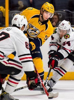 Nashville Predators left wing Kevin Fiala (56) shoots past Chicago Blackhawks center Tanner Kero (67) during the first period at Bridgestone Arena in Nashville, Tenn., Thursday, Dec. 29, 2016.  Andrew Nelles / The Tennessean