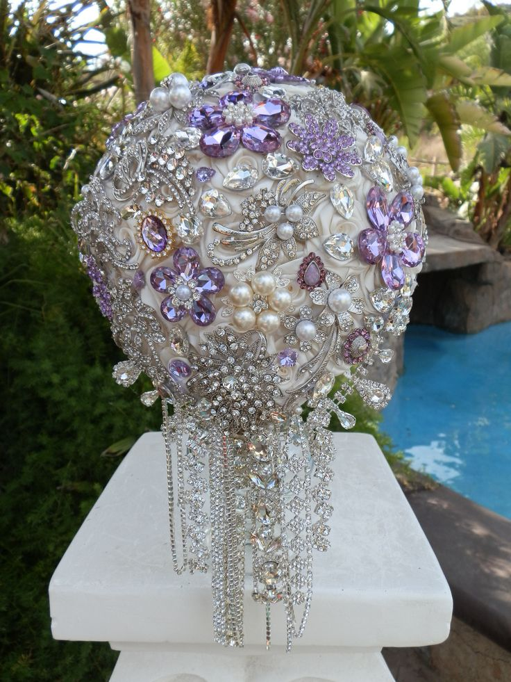 "Stunning 9"" White Cascading Bouquet with Purple Accents - $665.00 This is a Custom Made 9"" Cascading Full Brooch Bouquet, Absolutely Gorgeous Design, Simply Stunning !!! 13"" in Length, 25"" From top of"