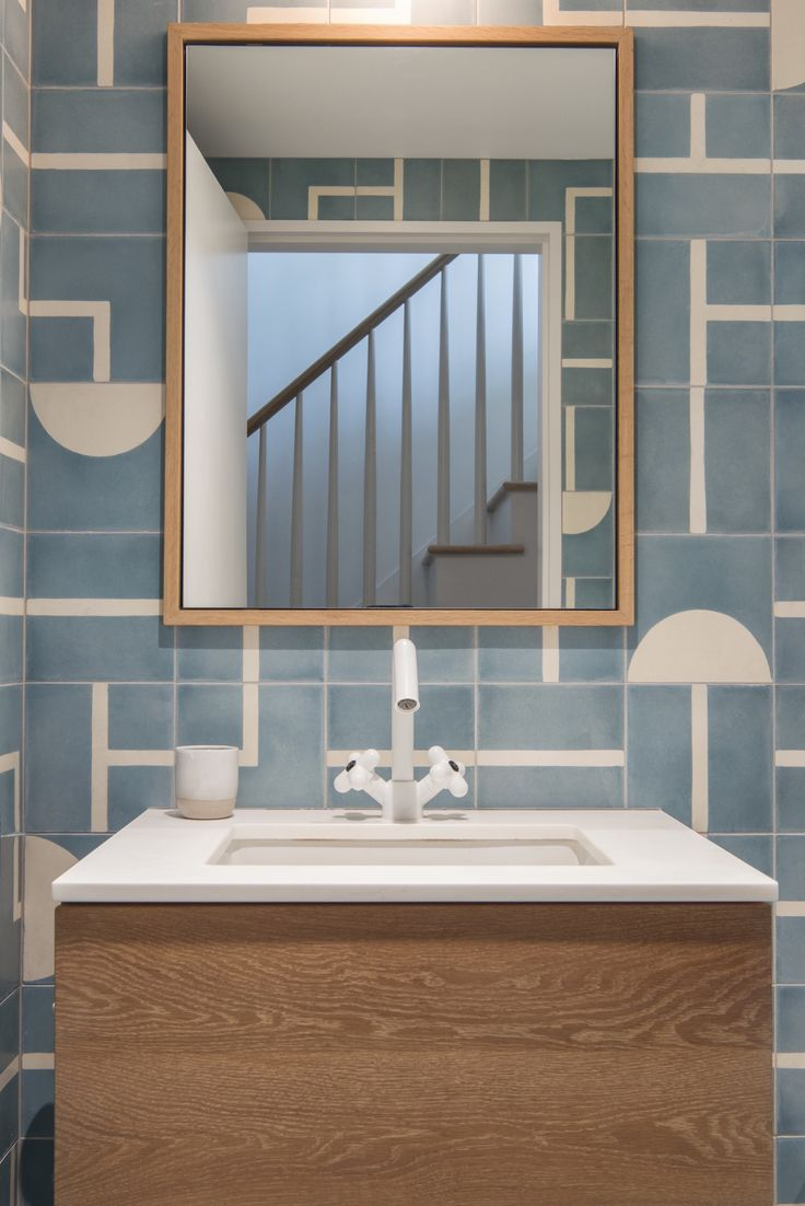 The kids' bath is lined in Brasilia cement tile from Popham Design with fixtures from Fantini.