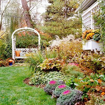 If your neighbors aren't into gardening like you are, take advantage of their neaby spaces to create the feel of a vista in your small garden landsape. This small backyard is packed with color and texture -- but the open views and soaring trees next door keeps it from feeling cramped.