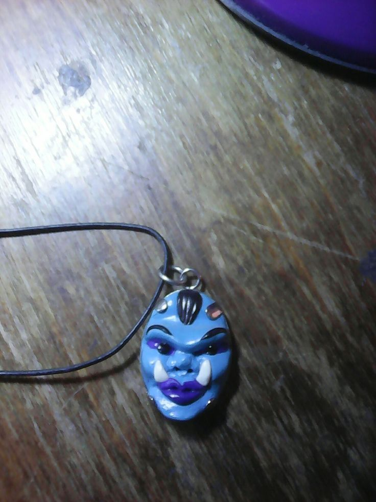 Blue Orc's head pendant