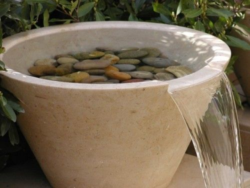I love the simplicity and the waterfall design.... OUTDOOR WATER FOUNTAIN BOWL W ROCKS... I like the rocks in the water. Poss done with a mesh/steel screen cut to fit into the pot. Cut edge for water flow great too.... cool looking not too elaborate but would hear water... simple water feature... water feature - simple, diy... outdoor fountain ls... Water feature... clean fountain pot with rocks... Peaceful zen fountain.... Water pot... Great looking fountain... water feature for…