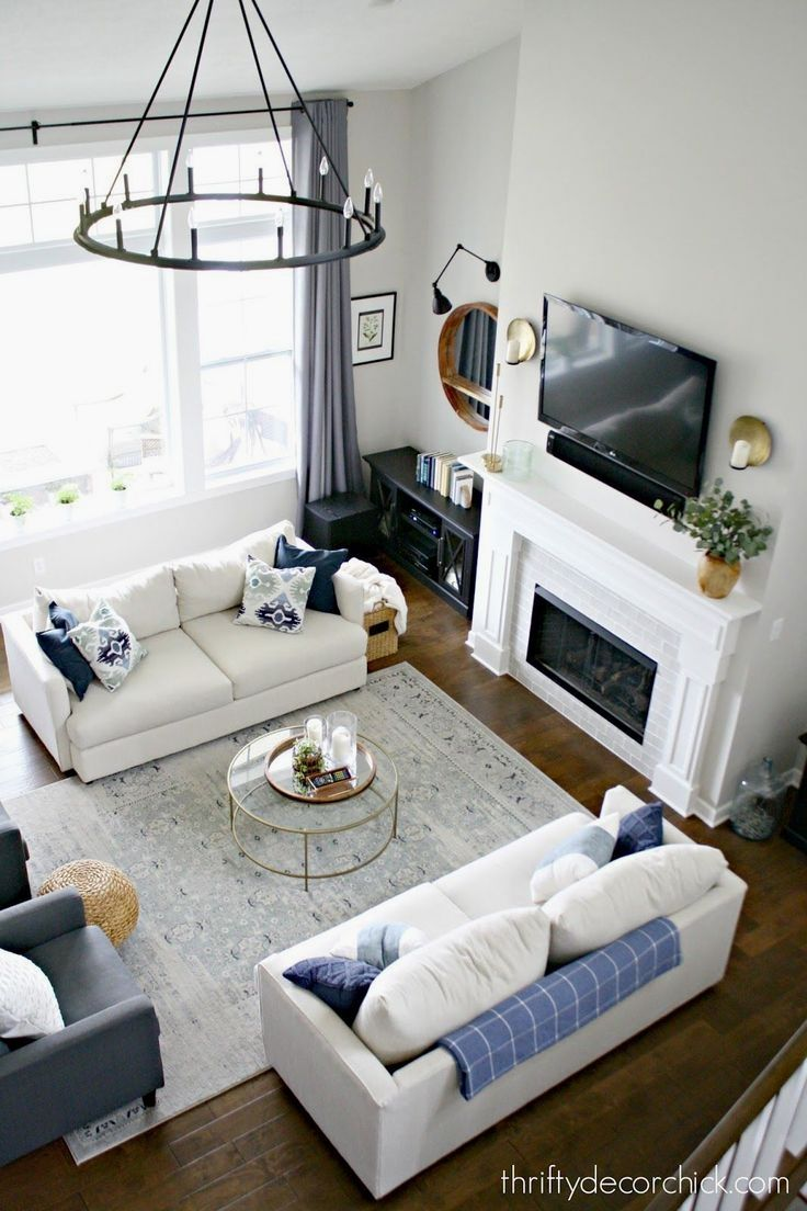 Our Living Rooms Wear A Lot Of Hats We Watch Tv Entertain Friends Have Conversations And S Living Room Furniture Layout Livingroom Layout Family Room Layout