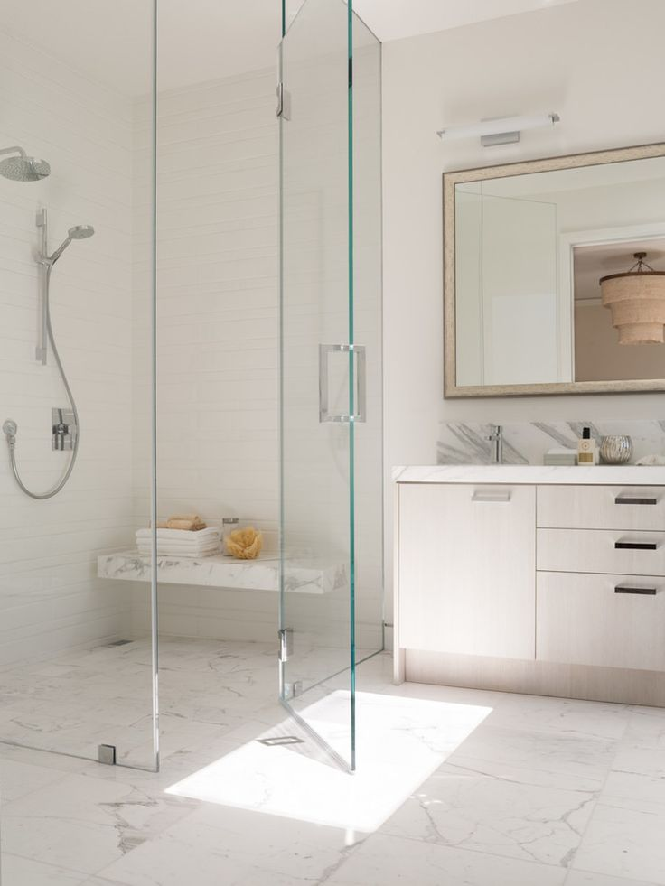 Showers without doors, also known as walk-in showers, have plenty of benefits. What are those?  Tags: bathroom design, doorless shower design, walk in shower, bathroom remodel, #DoorlessShower #WalkInShower #bathroomdesign #shower #luxury
