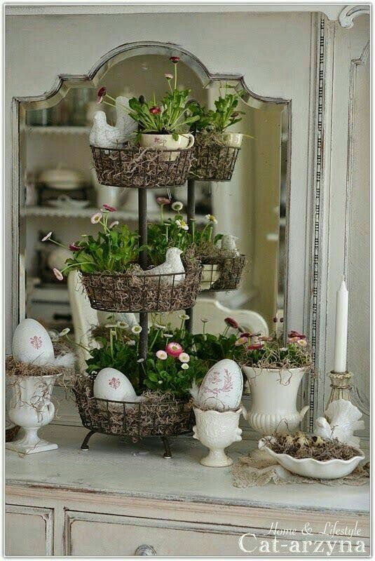 I've been seeing these tiered baskets in home goods and kitchen stores. I love how this one is filled with some filler material like Spanish moss to create three different levels for displaying eggs, bunnies, and flowers.