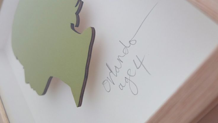Orlando. 3mm laser cut plywood silhouette. Hand painted in Wasabi. Cream mount. Hand written name/age in pencil. Custom hand made frame in oak. 250mm high x 230mm x 50mm deep.