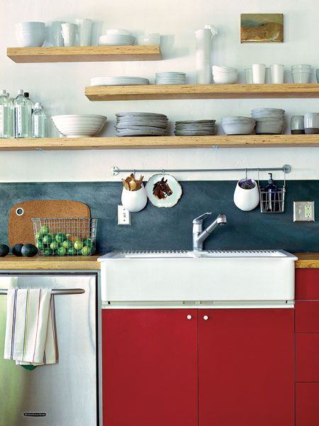 staggered wood open shelving in a somewhat modern nautical style, red Ikea cabinets, awesome Horse Plate,