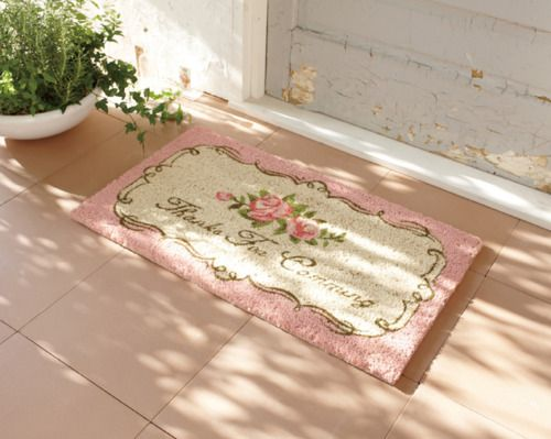 I love this shabby chic pink rug.