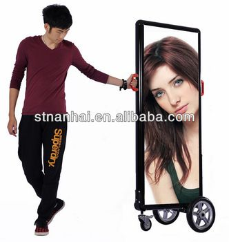 Go- Cart Mobile Billboard  - up to 06 hours of battery life  MODEL: JNDX-2-S(B)     1.  INTERNAL LED ILLUMINATED BACKLIGHTING  2.  BATTERY LIFE : 06 HOURS  3.  EXTERNAL SIZE(MM): 650*80*1500  4.  SCREEN SIZE(MM):  558*1408  5.  DOUBLE SIDE:  02 POSTERS  6.  N.W. : 13.3 KG  7.  COLOUR: BLACK