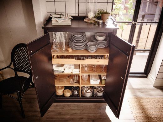 It's really practical to have a dining cabinet right by your entertaining space, so that everything's easy to find and keep separate (especially if it's special dinnerware).