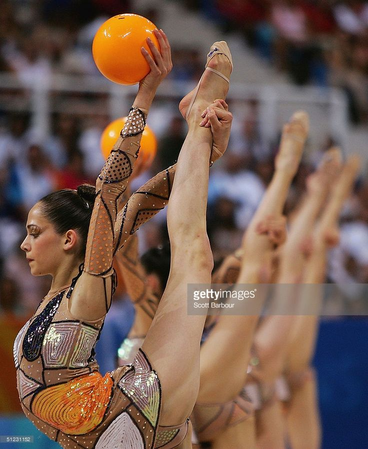 The Spanish team compete in the hoops and balls round of the rhythmic gymnastics group finals on August 28, 2004 during the Athens 2004 Summer Olympic Games at the Galatsi Olympic Hall in Athens, Greece.