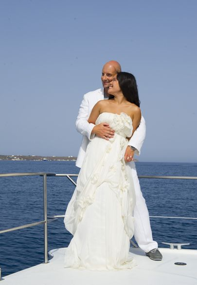 Private sailing experience and after wedding photoshoot at Santorini