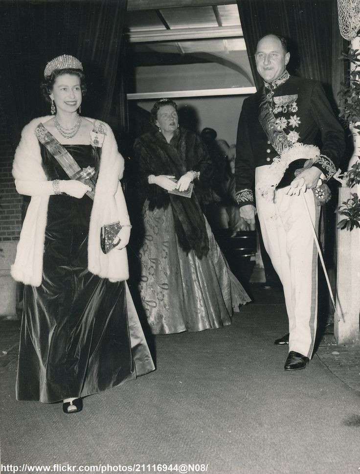 Queen Elizabeth arrives at reception 1958. Queen Elizabeth is guest of the Netherlands Government at the banquet given at The Hague.Queen is escorted by J.M.Luns,Foreign Minister