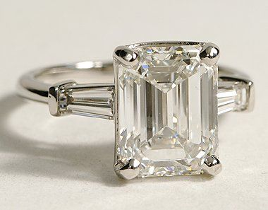 The perfect engagement ring: A simple emerald cut diamond framed by baguettes.