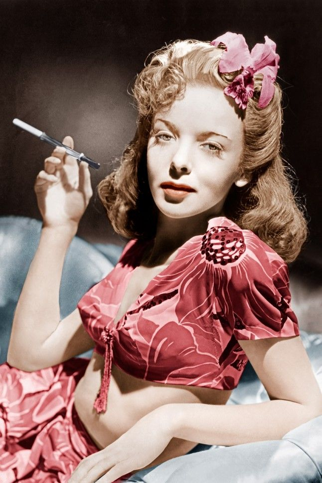 Ida Lupino, 1940s Actress-turned-director Ida rocks a printed crop top and matching skirt. And how fabulous is that cigarette holder? So sophisticated.