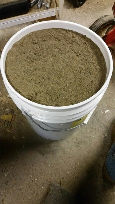 Green sand for casting. Made of 50 lbs play sand and roughly 5 lbs of pulverized cat litter (clay).
