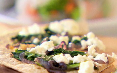 Rocket, caramelised onion and goat cheese pizza Recipe by Ellie Krieger