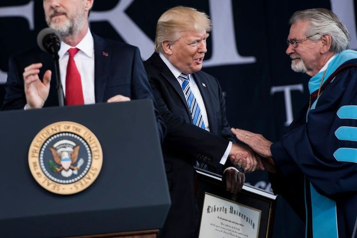 President of Liberty University Jerry Falwell (L) speaks while US President Donald Trump is presented with an honorary doctorate during Liberty University's commencement ceremony May 13, 2017 in Lynchburg, Virginia. / AFP PHOTO / Brendan Smialowski        (Photo credit should read BRENDAN SMIALOWSKI/AFP/Getty Images)