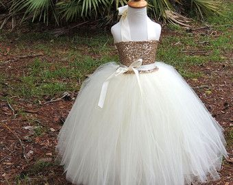 https://www.etsy.com/listing/238881718/ivory-sequin-tutu-dress-sequin-flower?ref=shop_home_active_3