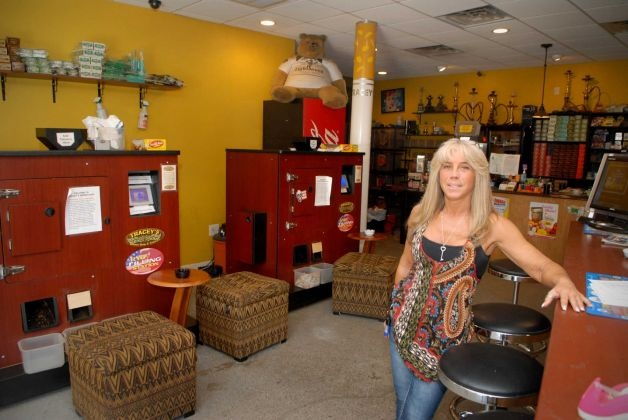 Tracey Scalzi, who owns smoke shops in Norwalk and Orange called Tracey's Smoke Shop and Tobacco LLC, at the Norwalk, Conn. location on Friday May 11, 2012. The state is trying to force her to pay cigarette taxes on roll-your-own smokes, either in court or through legislation    Read more: http://www.ctpost.com/local/article/For-now-roll-your-own-shops-can-breathe-easy-3552632.php#ixzz261gaAqIt