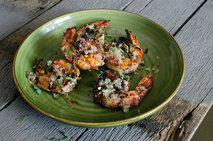 Garlic & chilli prawns with pepperberry, saltbush & finger lime
