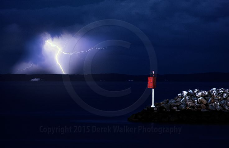 Lightning strikes Moreton Island, photographed from Redcliffe in Queensland, Australia. For image licensing enquiries, please feel welcome to contact me at derekwalker73@bigpond.com  Cheers :)