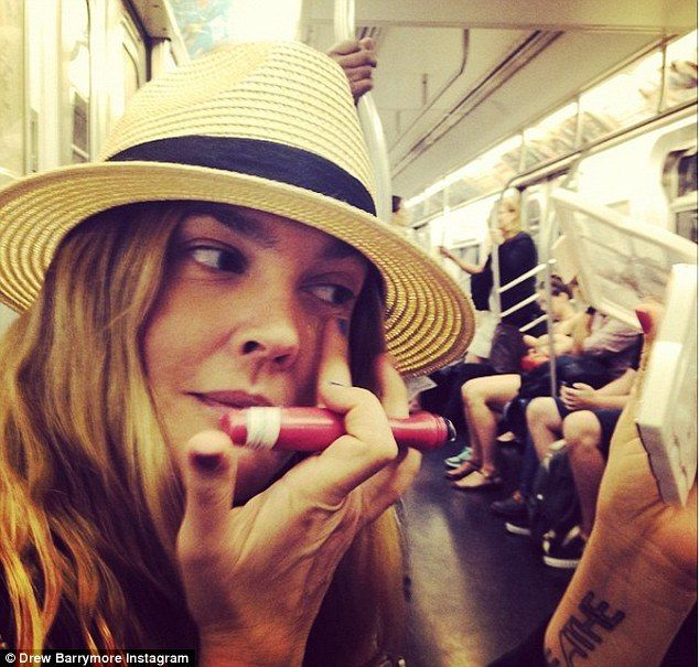 Crunched for time? Drew Barrymore shared a photo of herself applying make-up while riding the subway in a photo shared on her Instagram acco...