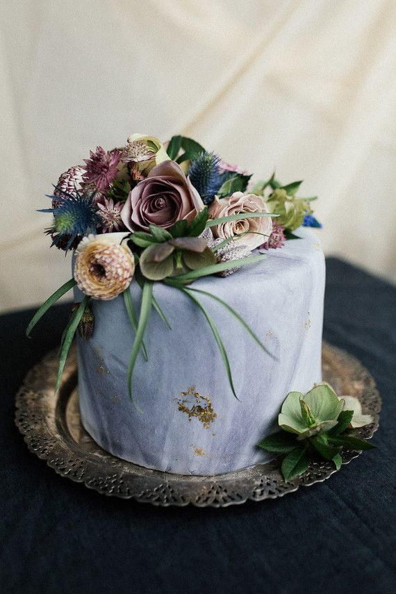 Wedding cake in pastel blues and violets.