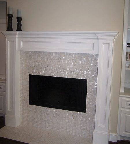 I love the pearlescent mosaic tiles around the fireplace! This would look  amazing around my