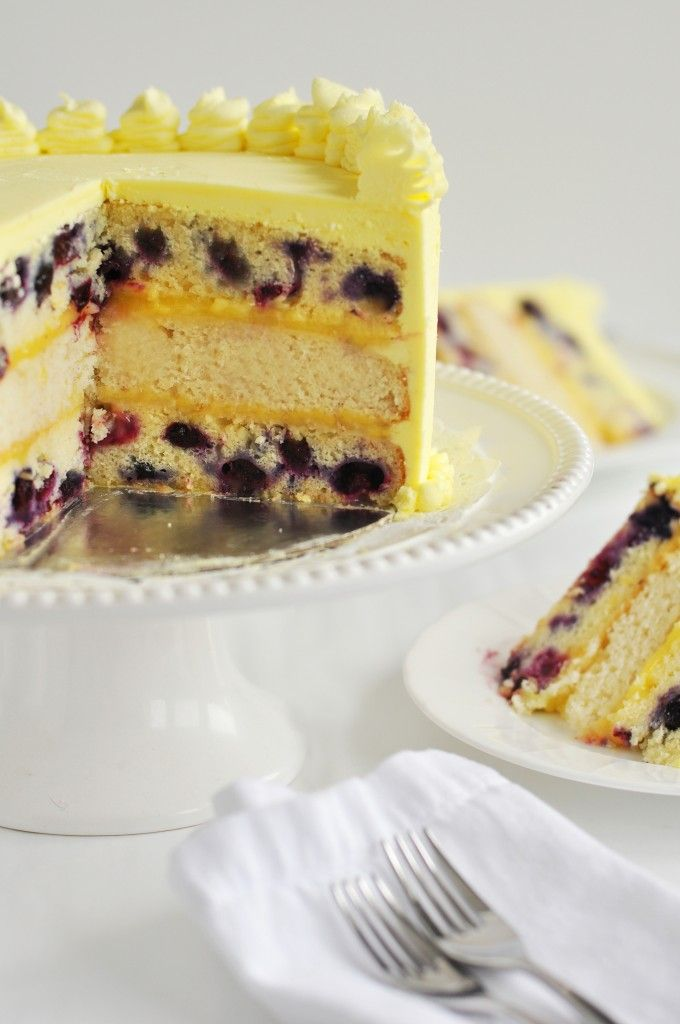 Triple--Lemon Blueberry Layer Cake with Zesty Lemon Frosting and filled with Lemon Curd.