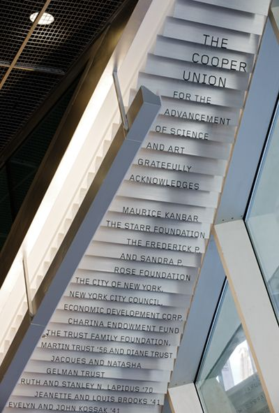 The Cooper Union, donor signage cascades down the underside of a lobby staircase