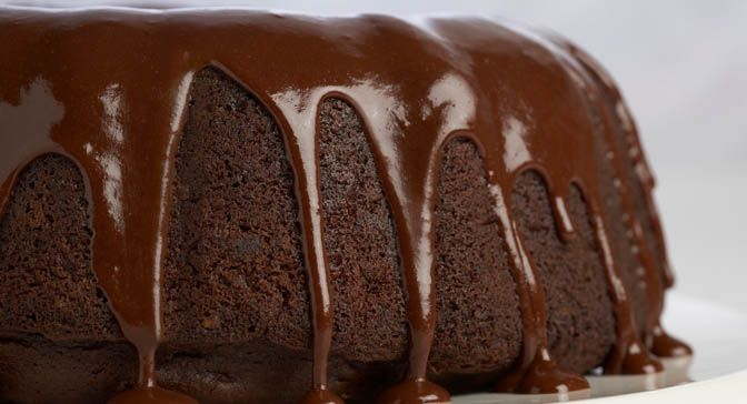 Enhance a devil's food cake mix with semi-sweet chocolate chips and a rich Chocolate Glaze and you will have a dessert good enough for company. By varying the flavoring extract you can make a different cake every time.