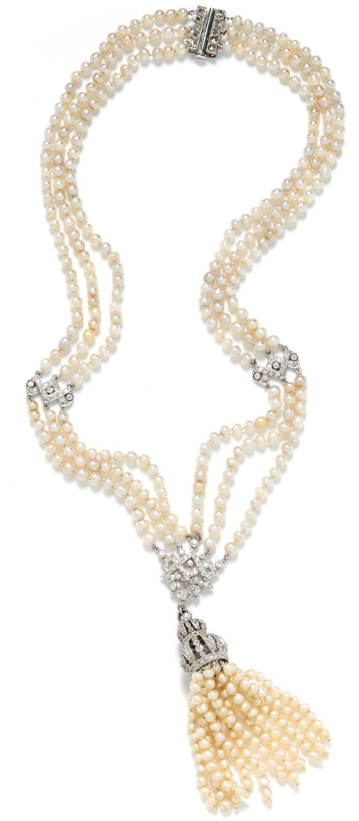 A beautiful antique Art Deco era pearl tassel necklace, with 12 strands of pearls and 137 diamonds.