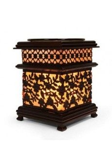 "Asian style oil warmer measures 6"" tall. Simulated wood stand. Uses one 35 watt halogen bulb (included). Oil dish is removal for easy clean up."